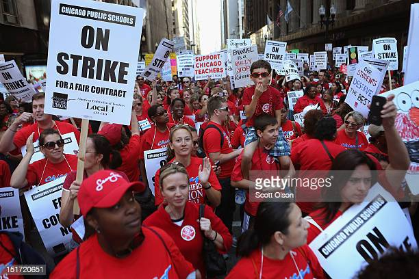 Thousands of Chicago public school teachers and their supporters march through the Loop and in front of the Chicago Public Schools headquarters on...