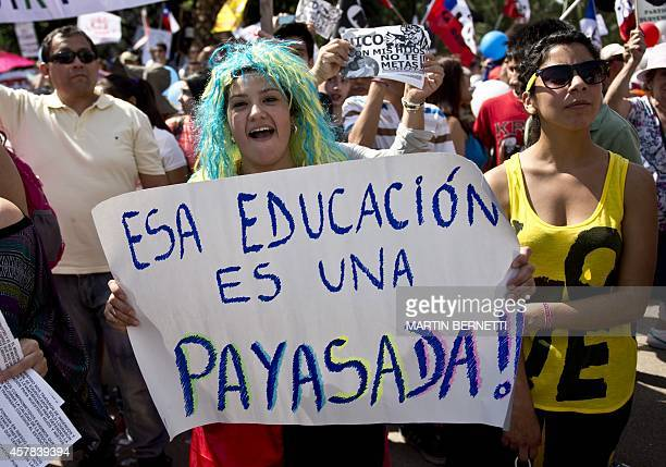 Thousands of Chilean students and their parents march in front of La Moneda presidential palace protesting against the new education system in...