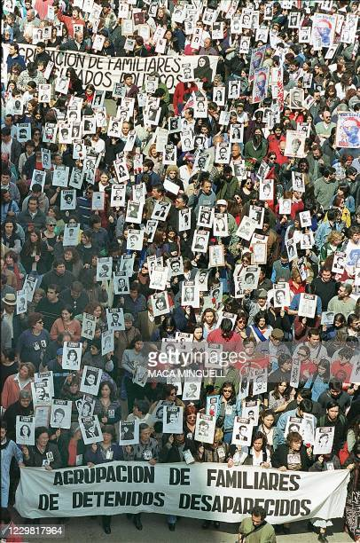 Thousands of Chileans take to the streets 11 September, 1999 in Santiago during a parade marking the 26th anniversary of the coup that brought...