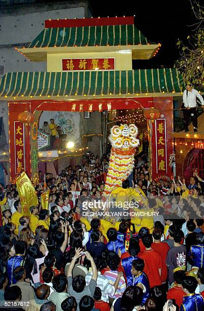 Thousands of Chinese celebrate the Lunar New Year in China Town in Calcutta late 08 February 2005 The colourful dragon dance and the traditional...