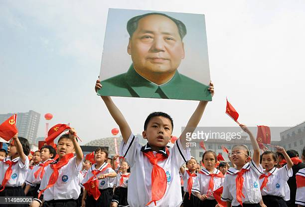 Thousands of Chinese students holding Communist flags and a portrait of China's late leader Mao Zedong gather to mark the 90th anniversary of the...