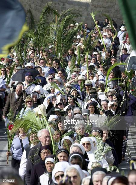 Thousands of Christian Pilgrims in Jerusalem celebrate Palm Sunday March 24 2002 by retracing the steps of Jesus Christs historic entrance into the...