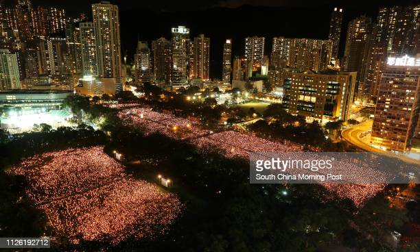 Thousands of citizens attend the candlelight vigil commemorating the 25th anniversary of June 4th Tiananmen Crackdown at Victoria Park, Causeway Bay....