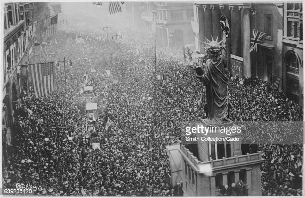 Thousands of citizens gather and march to celebrate the announcement of the World War One armistice on November 11 flooding the streets around the...