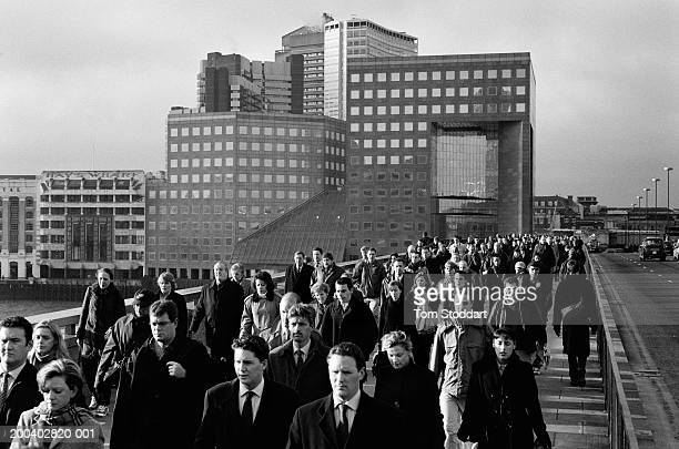 Thousands of city workers make their early morning trek from the railway station across London Bridge to their offices in the heart of the 'square...