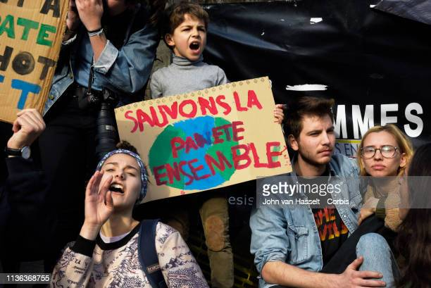 Thousands of climate campaigners march from l'Opéra to Place de la République to protest what they call the inaction on climate change by the French...