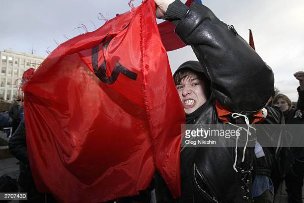 """Thousands of Communists march through the streets to mark the """"Day of Accord and Reconciliation"""" November 7, 2003 in Moscow, Russia. Russia is..."""