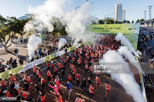 Thousands of competitors race from the start line of the Nike Women's Half Marathon at Sydney Olympic Park on July 3 2016 in Sydney Australia
