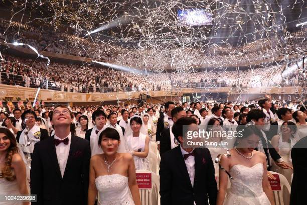 Thousands of couples attend a mass wedding held by the Family Federation for World Peace and Unification aka Unification Church on August 27 2018 in...