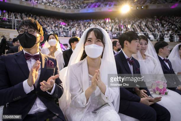 Thousands of couples attend a mass wedding held by the Family Federation for World Peace and Unification, aka Unification Church despite the spread...