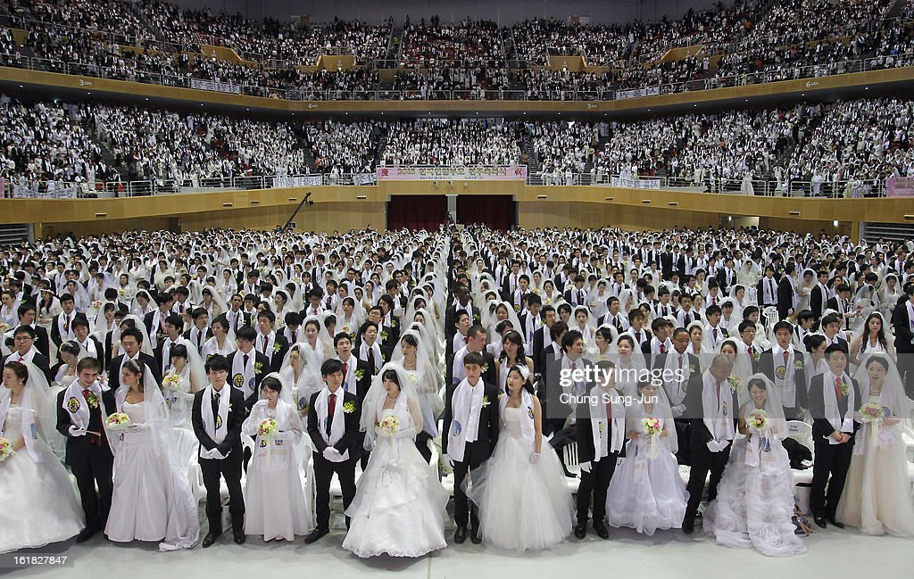 Thousands of couples take part in a mass wedding ceremony at Cheongshim Peace World Center on February 17, 2013 in Gapyeong-gun, South Korea. 3,500 couples from 200 countries around the world exchanged wedding vows for the first time after the Unification Church founder Moon Sun-Myung passed away.