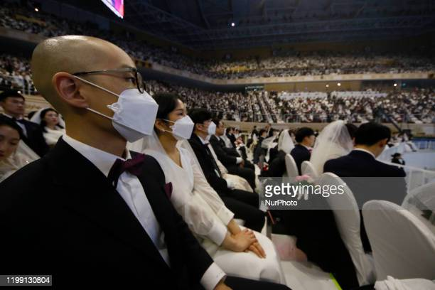 Thousands of couples take part in a mass wedding of the Family Federation for World Peace and Unification commonly known as the Unification Church at...