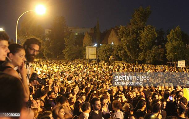 Thousands of Cypriots gather outside the presidential palace in Nicosia on July 14 2011 during a protest demanding the resignation of President...