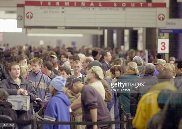 Thousands of Delta Air Lines passengers await a chance to get to the main ticket counter January 3 2002 at Hartsfield Atlanta International Airport...