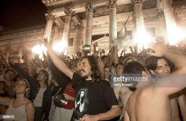 Thousands of demonstrators bang pots outside the National Congress House December 20 2001 in Buenos Aires Argentina President Fernando De la Rua...