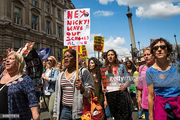 Thousands of demonstrators chanting and holding placards march towards Parliament Square during a strike by The National Union of Teachers on July 5...