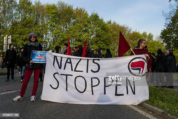Thousands of demonstrators during a protest against the rightwing conservative Alternative for Germany through the city in Stuttgart Germany 30 April...