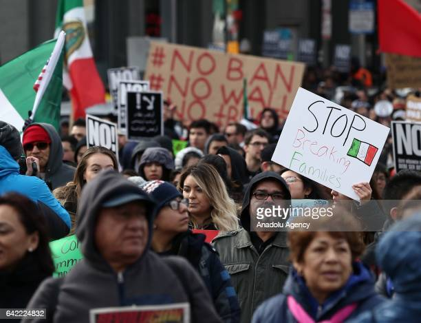 Thousands of demonstrators hold banners and flags during a rally against US President Donald Trump's order and his recent policies regarding cracking...