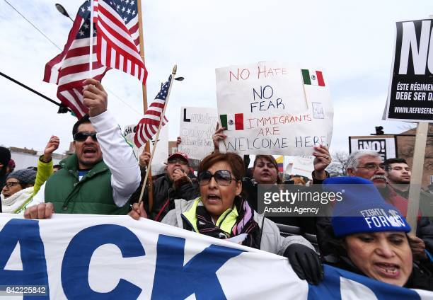 Thousands of demonstrators hold banners and shout slogans during a rally against US President Donald Trump's order and his recent policies regarding...