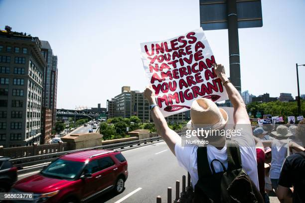 Thousands of Demonstrators hold placards and march to protest US President Donald J Trump and his immigration policy concerning Muslims and...