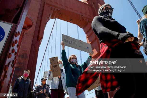 Thousands of demonstrators make their way across the Golden Gate Bridge in San Francisco, Calif. Saturday, June 6, 2020 during a march in support of...