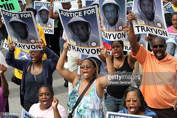 Thousands of demonstrators march along W 13th Street in Sanford Florida during a NAACP rally and march demanding for justice in the shooting of...