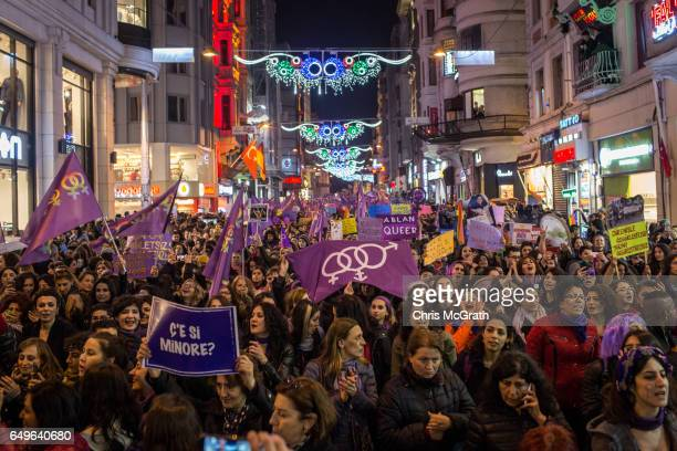 Thousands of demonstrators march down Istanbul's famous Istiklal street during a rally for International Women's Day on March 8 2017 in Istanbul...