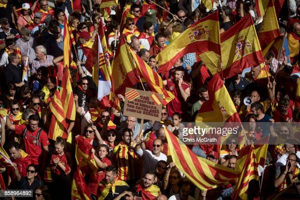 Thousands of demonstrators march during a protest against Catalonia's indepedence on October 8 2017 in Barcelona Spain Large numbers of citizens are...