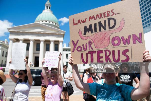 Thousands of demonstrators march in support of Planned Parenthood and pro-choice as they protest a state decision that would effectively halt...