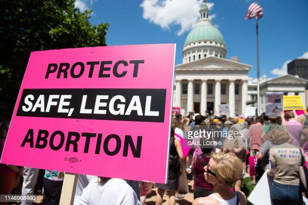 Thousands of demonstrators march in support of Planned Parenthood and prochoice as they protest a state decision that would effectively halt...