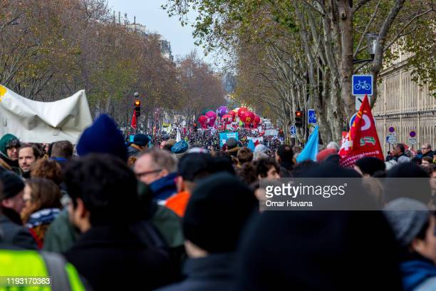 Thousands of demonstrators march in the streets of downtown Paris during the sixth day of a general strike on December 10 2019 in Paris France Some...