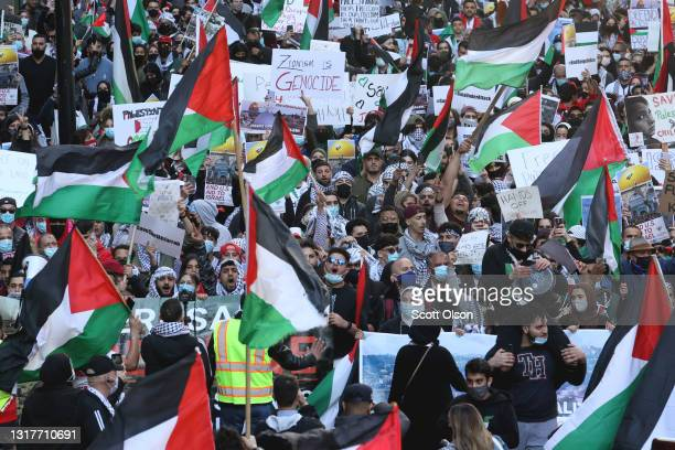 Thousands of demonstrators march through downtown protesting Israeli airstrikes in the Gaza Strip on May 12, 2021 in Chicago, Illinois. The death...