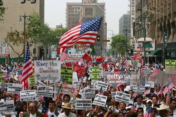 Thousands of demonstrators march through downtown to City Hall in one of several May Day marches and rallies in southern California and in at least...