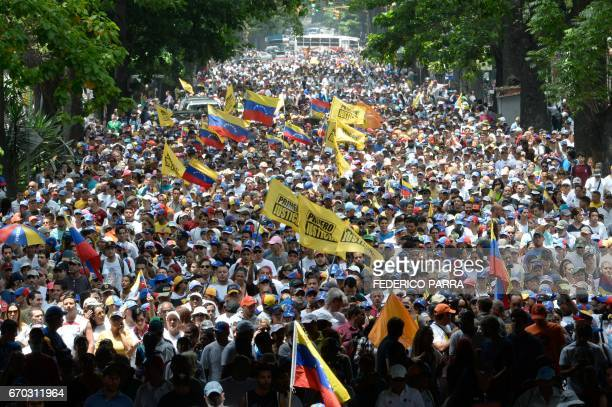 Thousands of demonstrators rally against Venezuelan President Nicolas Maduro in Caracas on April 19 2017 Clashes broke out Wednesday at massive...