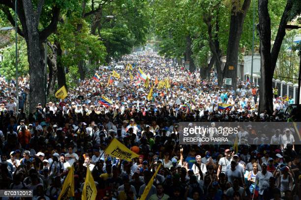 TOPSHOT Thousands of demonstrators rally against Venezuelan President Nicolas Maduro in Caracas on April 19 2017 Clashes broke out Wednesday at...