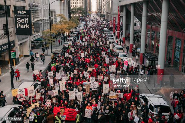 Thousands of demonstrators take to the streets stopping traffic and circling City Hall in a show support for the ongoing teachers strike on October...