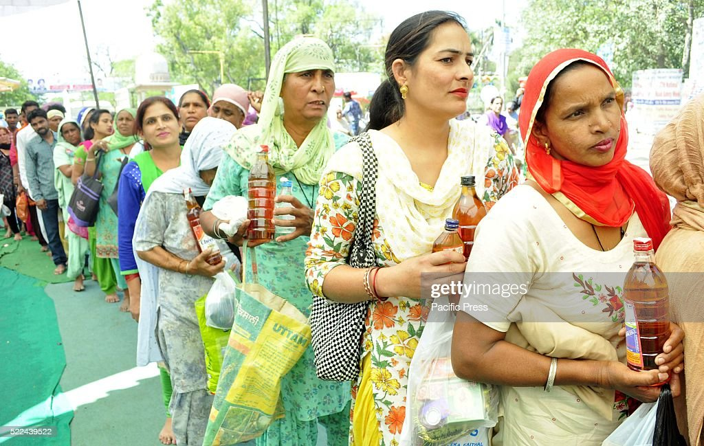Thousands of devotees carrying bottles of wine standing in a long queue waiting for their turn for paying obeisance on the occasion of Ashtami...