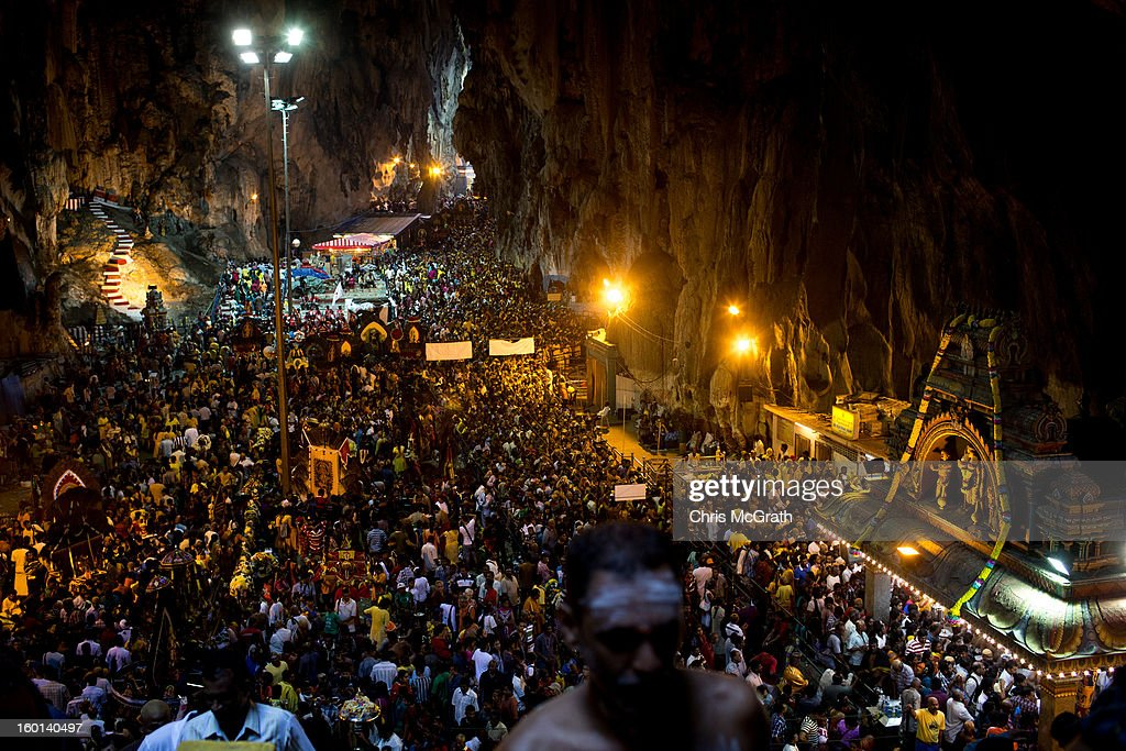 Thousands of devotees pack the Batu Caves at the end of their Thaipusam procession on January 27, 2013 in Batu Caves, Malaysia. Thaipusam is a Hindu festival celebrated on the full moon in the Tamil month of Thai. The festival marks the birthday of Lord Muruga and also commemorates the day Hindu Goddess Parvati gave her son a lance to defeat the evil demon Soorapadamwhen. The festival sees devotees carry milk pots to seek forgivness and some will carry a 'Kavadi' many of which are attached via, strings, hooks, and skews pierced into the carriers skin.