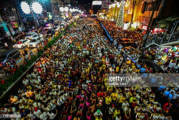 Thousands of devotees participate in an annual Thanksgiving procession with the image of the Black Nazarene in Manila on December 31 2019 Thousands...