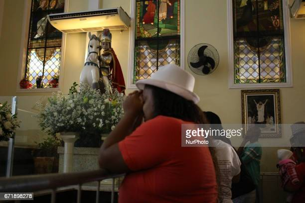 Thousands of devotees take part in the celebrations at the Church of St George in Quintino north of Rio de Janeiro on April 23 2017 The Holy Warrior...