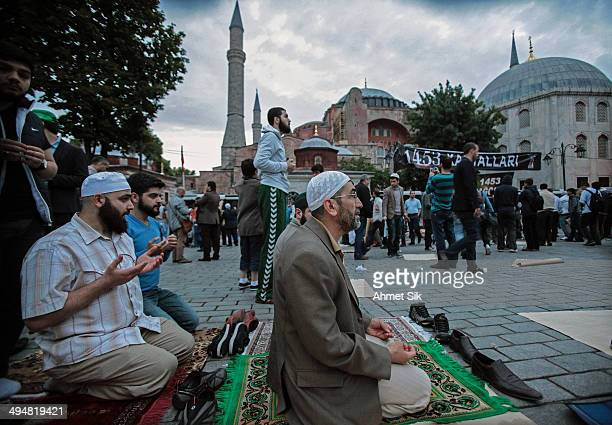 Thousands of devout Muslims pray outside Turkey's historic sixth century Byzantinian monument Hagia Sophia on May 31 2014 in Istanbul Turkey Muslim's...