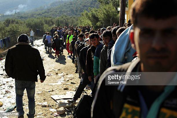 Thousands of displaced Syrians Iraqis and Afghan's wait in deteriorating conditions to enter at a reception center on the island of Lesbos on October...