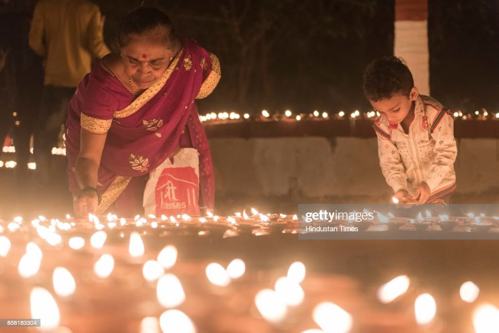 Thousands of Diyas lighten up by devotees during 'Laksha Deepotsav' festival on the occasion of Sharad Purnima at Swami Gagangiri Maharaj Ashram, Manori Donger, Malad, on October 5, 2017 in Mumbai, India. Sharad Purnima is a harvest festival celebrated on the full moon day of the Hindu lunar month of Ashvin, marking the end of the monsoon season. The Kojagari Purnima concerns the observance of the Kojagara Vrata.