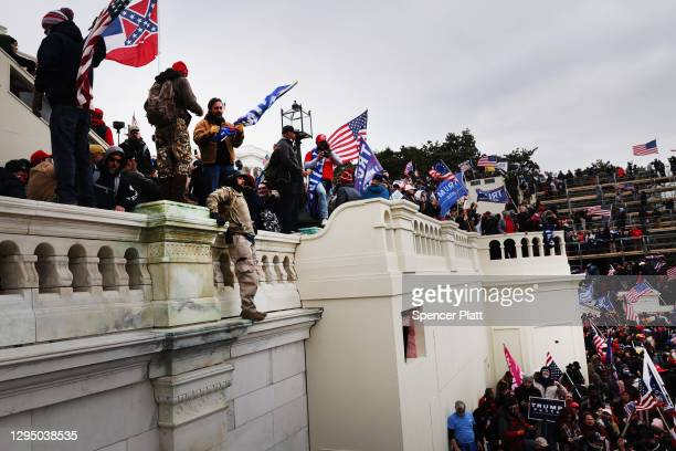 "Thousands of Donald Trump supporters storm the United States Capitol building following a ""Stop the Steal"" rally on January 06, 2021 in Washington,..."