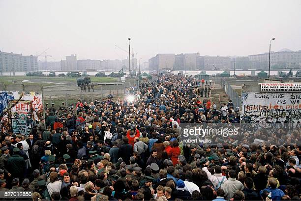 Thousands of East Germans stream through the Berlin Wall a few days after it's opening on November 9th 1989 when the East German Government announced...