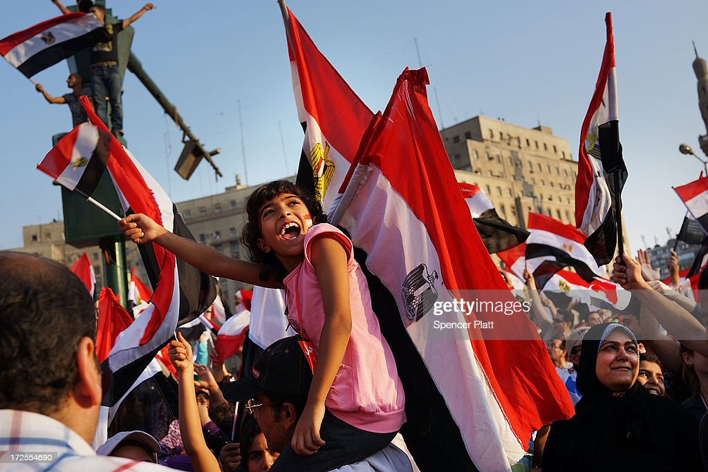 Thousands of Egyptian protesters celebrate in Tahrir Square as the deadline given by the military to Egyptian President Mohammed Morsi passes on July 3, 2013 in Cairo, Egypt. The president gave a defiant speech last night and vowed to stay in power despite the military threats. As unrest spreads throughout the country, at least 23 people were killed in Cairo on Tuesday and over 200 others were injured. It has been reported that the military has taken over the state television.
