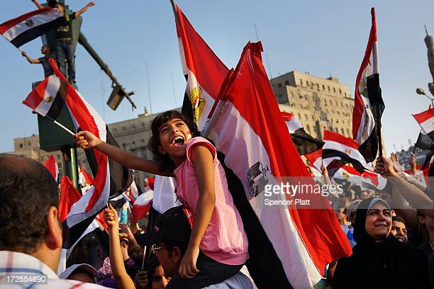 Thousands of Egyptian protesters celebrate in Tahrir Square as the deadline given by the military to Egyptian President Mohammed Morsi passes on July...