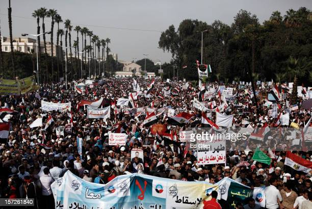Thousands of Egyptian protesters take part in a demonstration supporting Egyptian President Mohammed Morsi in front of Cairo University December 30...