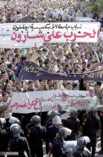 Thousands of Egyptian university students holding antiUS an antiIsrael banners face riot police as they take to the streets of Egypt's Mediterranean...