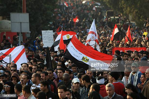 Thousands of Egyptians march in a protest from AlAhly club to the headquarters of the ministry of interior in Cairo on February 2 2012 against the...